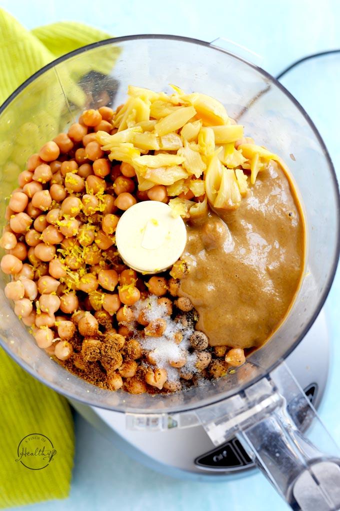 food processor with hummus ingredients before blending