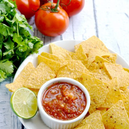 This easy homemade salsa is a real crowd pleaser, y'all. It's a seven ingredient recipe, and you can make it a blender or food processor. | APinchOfHealthy.com