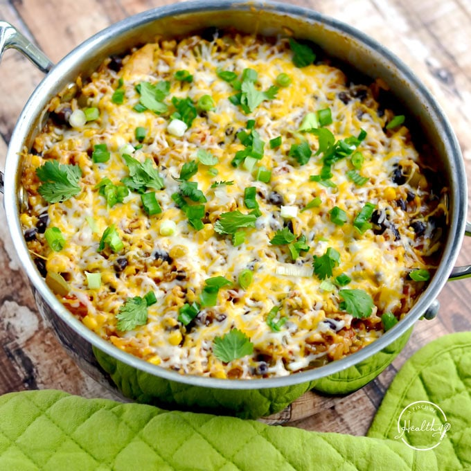 One Pot Chicken Enchilada Skillet with chicken, rice, black beans, corn, tomatoes, enchilada sauce and cheese.