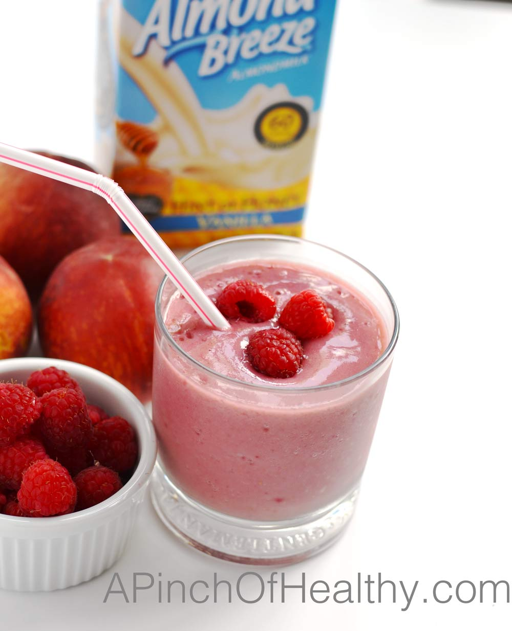 Raspberry Peach Smoothie - 4 ingredients and so delicious! | APinchOfHealthy.com