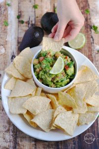 Today I am showing you how to make guacamole from scratch. My version is packed with veggies, and it is a delicious appetizer or snack. | APinchOfHealthy.com