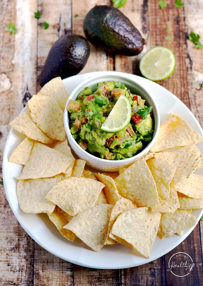 Today I am showing you how to make guacamole from scratch. My version is packed with veggies, and it is a delicious appetizer or snack.