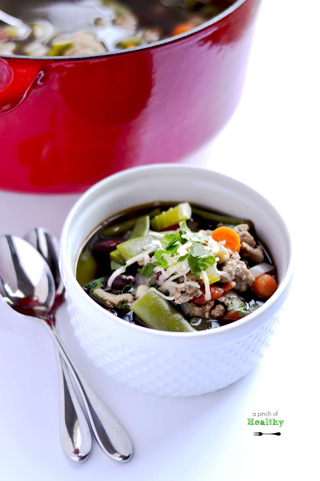 Turkey Vegetable Soup - a hearty soup chocked with veggies and ground turkey. So easy, filling and delicious!   APinchOfHealthy.com
