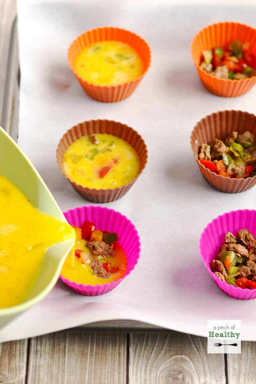 Egg Muffins with Turkey Sausage and Peppers| APinchOfHealthy.com