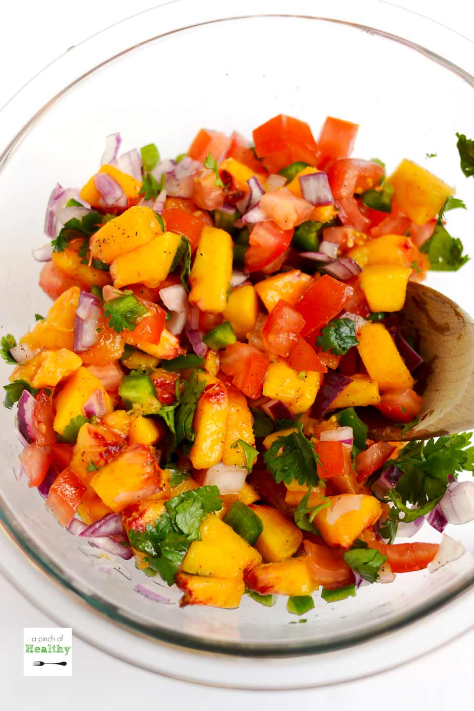 This easy peach salsa is the perfect summer appetizer, and it is great on chips or as a topper on grilled fish or chicken. | A Pinch of Healthy