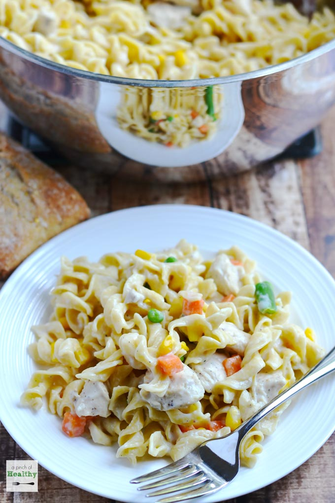 One pot creamy chicken noodle skillet is a comforting and easy meal that your whole family will love! | APinchOfHealthy.com