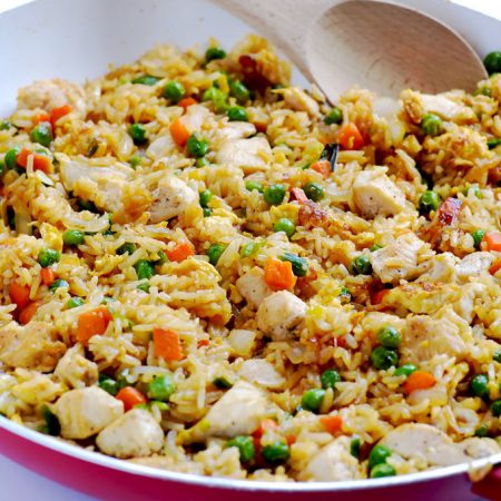Skip the takeout and make this easy chicken fried rice at home. It's a simple weeknight dinner that's so budget friendly, and it's a real crowd-pleaser! | APinchOfHealthy.com