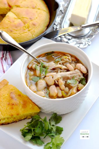 Instant pot white chicken chili is super easy and delicious dinner that comes together in less than thirty minutes.   APinchOfHealthy.com