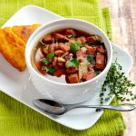 This ham and 15 bean soup is a delicious and comforting family favorite, and it is our favorite way to use up leftover ham. | APinchOfHealthy.com