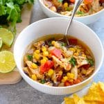 Instant pot chicken tortilla soup in white bowl with spoon