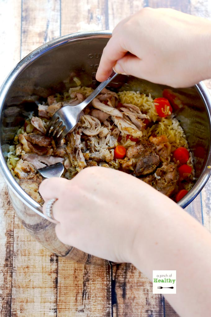 Instant Pot chicken and rice is a delicious and simple supper that you can make all in one pot.   APinchOfHealthy.com