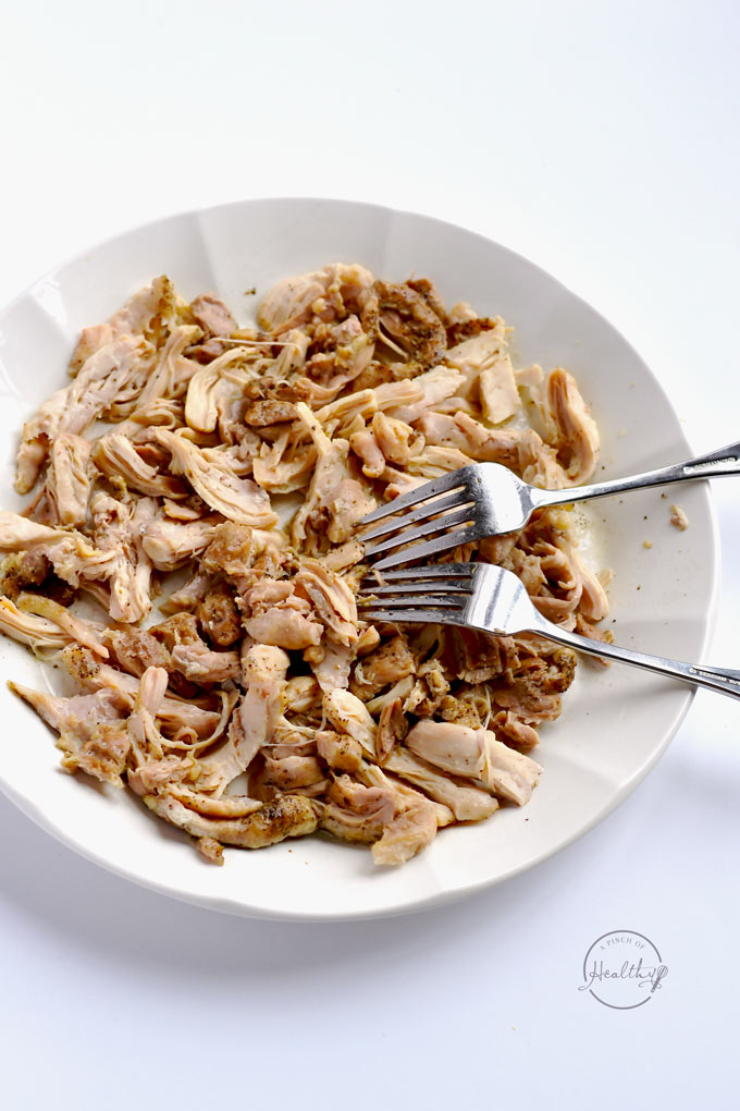 This is the easiest, no-fail way to make shredded chicken in your Instant Pot. And you can use it in so many different recipes! | APinchOfHealthy.com