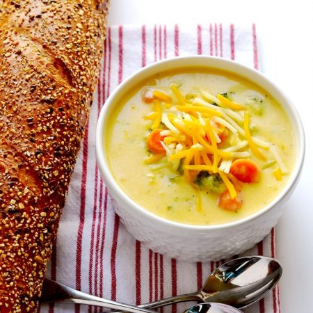 Broccoli cheese soup is creamy, comforting and delicious, and you would never know that this recipe uses no heavy cream. | APinchOfHealthy.com