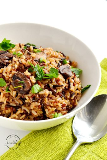 Instant Pot wild rice pilaf is a simple and delicious side dish you are going to love!   APinchOfHealthy.com