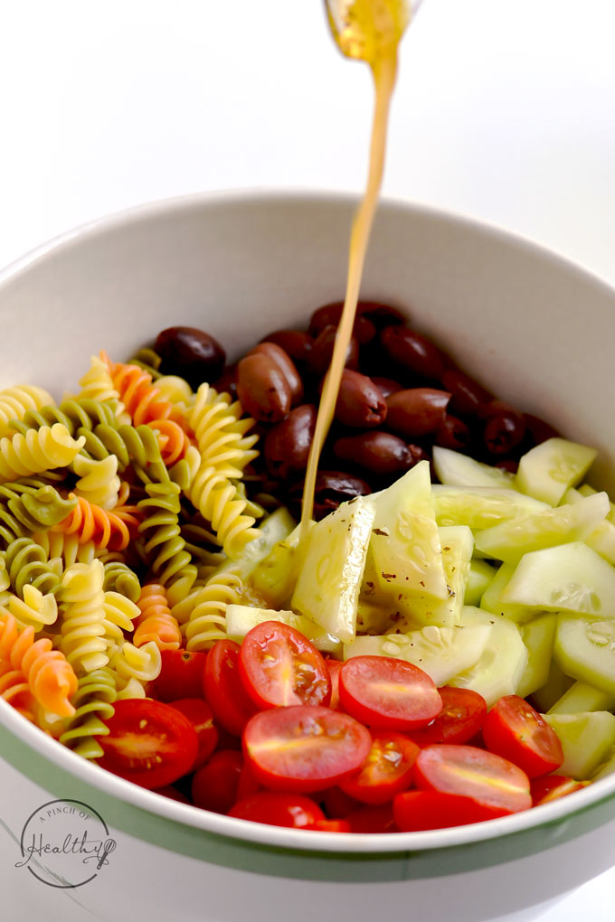 Greek pasta salad is a tangy and fresh dish that is perfect for a picnic or potluck. | APinchOfHealthy.com