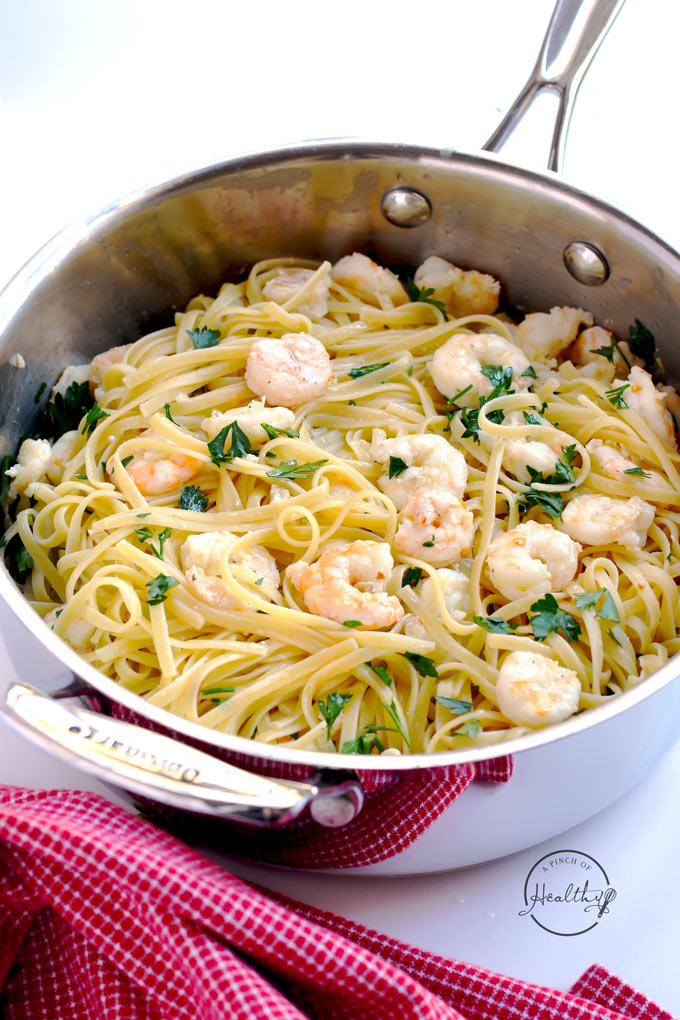 Shrimp scampi over linguine is a delicious and simple dinner that comes together in less than thirty minutes. | APinchOfHealthy.com