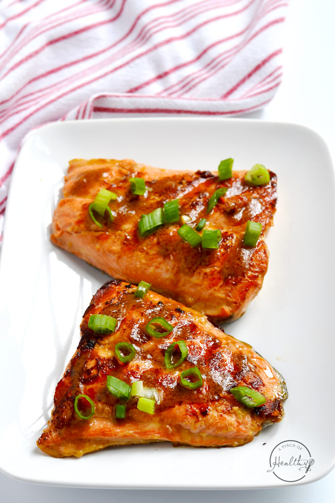 This easy grilled salmon is a quick-cooking dinner that takes less than twenty minutes to make and tastes amazing! | APinchOfHealthy.com