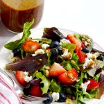 This summer salad with berries, goat cheese and pine nuts is such a simple and elegant dish, bursting with seasonal flavor. | APinchOfHealthy.com