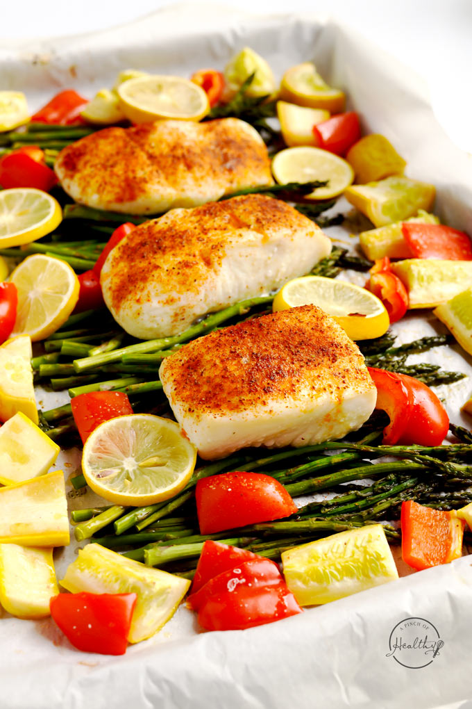 This halibut sheet pan dinner with asparagus, red pepper and summer squash is the perfect no fuss dinner for busy families. | APinchOfHealthy.com
