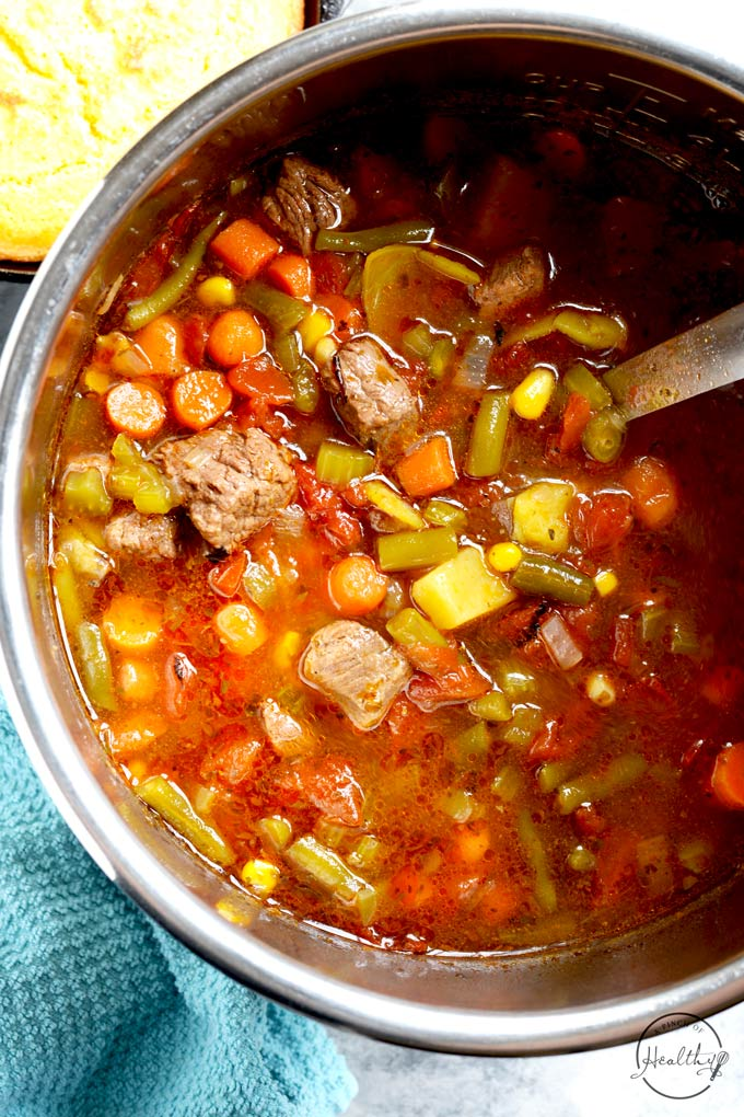 Instant Pot vegetable beef soup from overhead with ladle