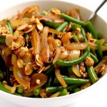 Green beans with caramelized onions and almonds is a great way to dress up green beans for a holiday, special occasion or dinner party. | APinchOfHealthy.com