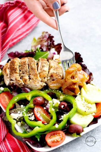 Greek salad with grilled chicken sliced on top