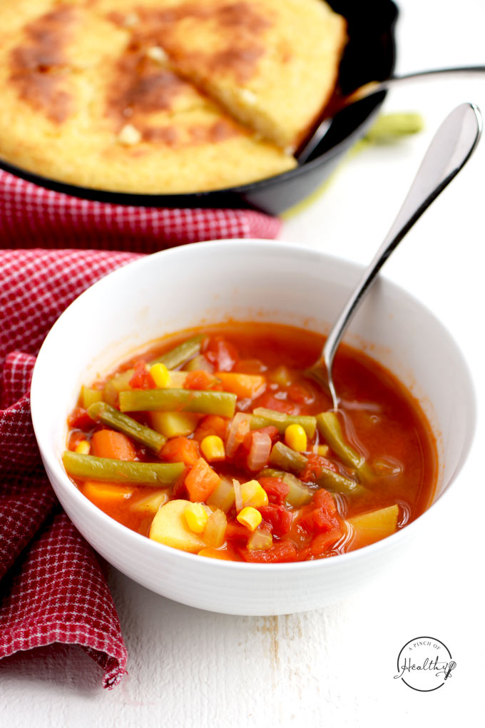 Tomato vegetable soup is a simple, comforting and tasty way to eat more veggies. And you can make it on the stovetop or in your Instant Pot. | APinchOfHealthy.com