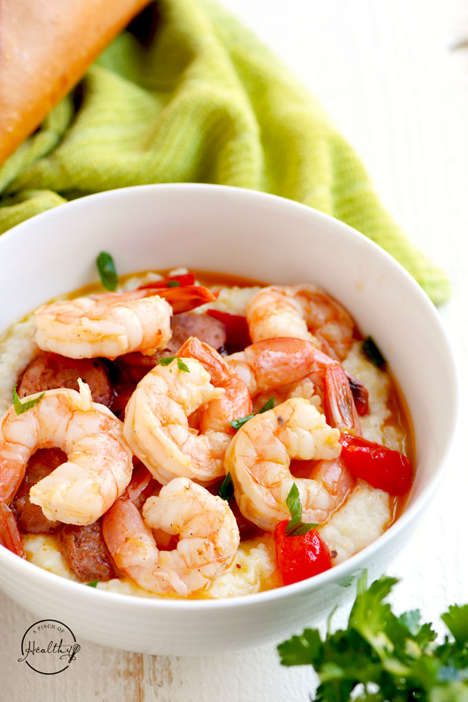Cajun shrimp and garlic parmesan cheese grits with andouille sausage