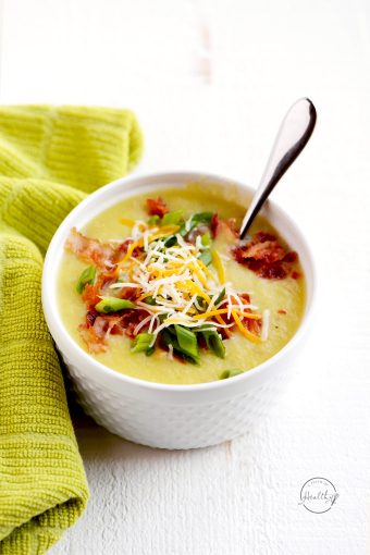 Irish potato leek soup with cheese, green onions and bacon