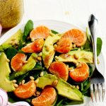 Spinach salad with mandarin oranges, avocado, pine nuts and balsamic vinaigrette