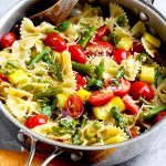 Pasta primavera with squash, asparagus, shallot, garlic, tomatoes