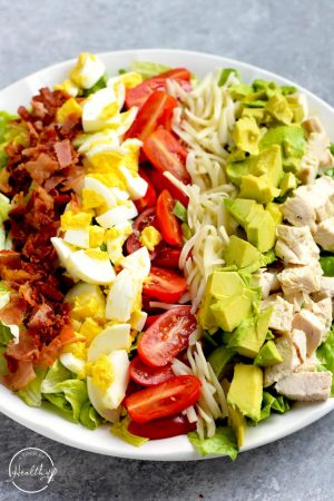 Cobb salad chicken bacon avocado, cheese, tomatoes, eggs, lemon and olive oil