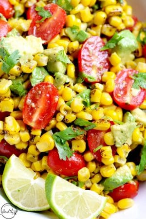 Corn salad with avocado tomato and lime dressing