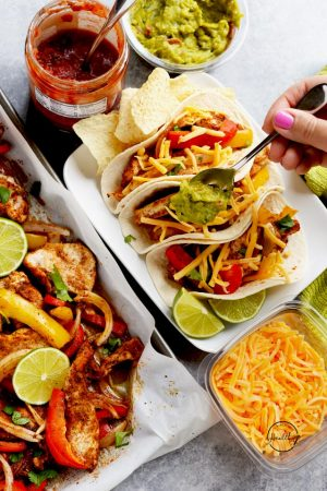 Easy chicken fajitas baked on a sheet pan