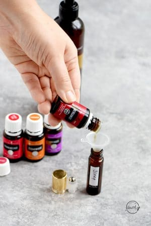 adding bergamot to essential oil sleep support blend with funnel