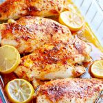 Baked chicken breast with lemon in clear pyrex dish