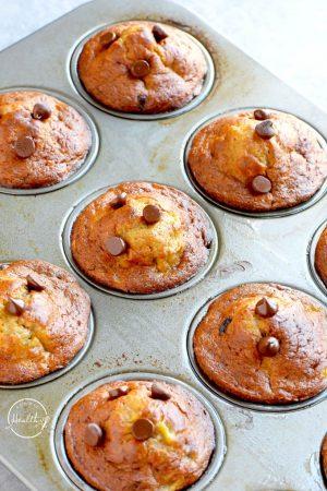 banana chocolate chip muffins closeup in a muffin tin