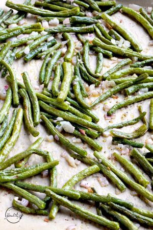 Roasted green beans on sheet pan cooked with shallots