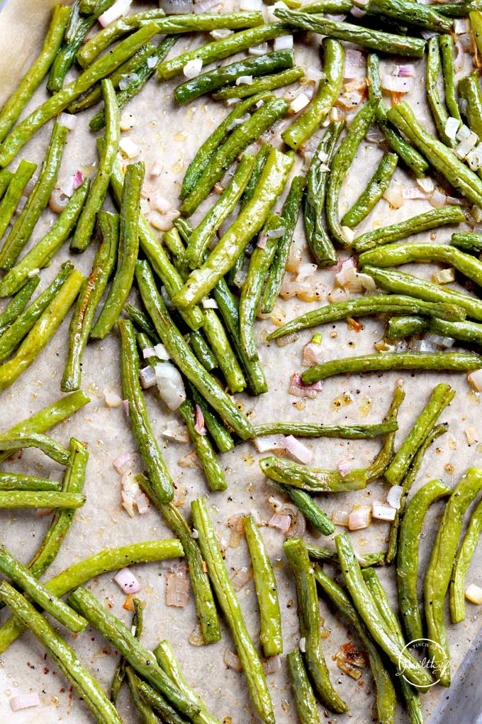 roasted green beans with shallot on a sheet pan from overhead