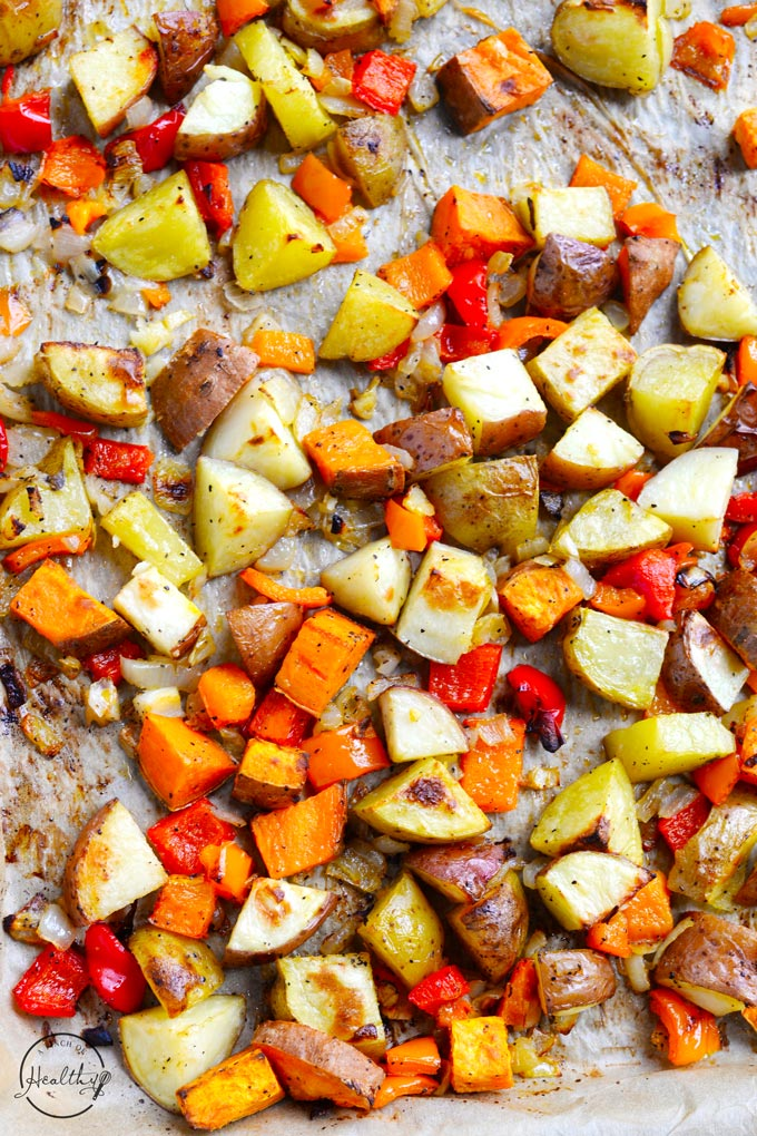 breakfast potatoes with peppers and onions on sheet pan