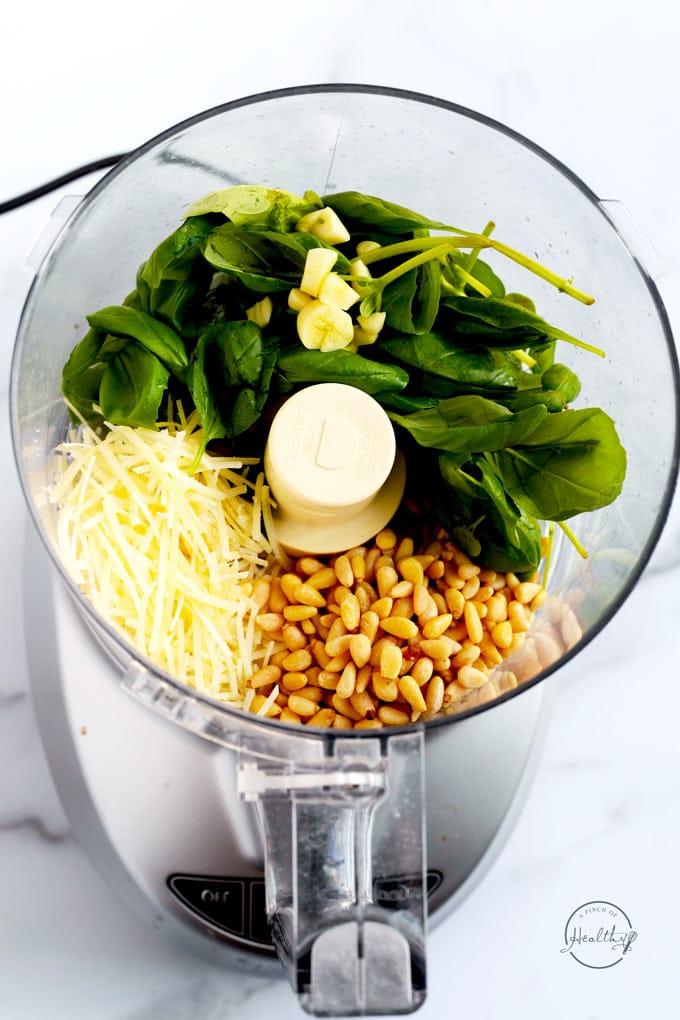 pesto ingredients in a food processor prior to blending