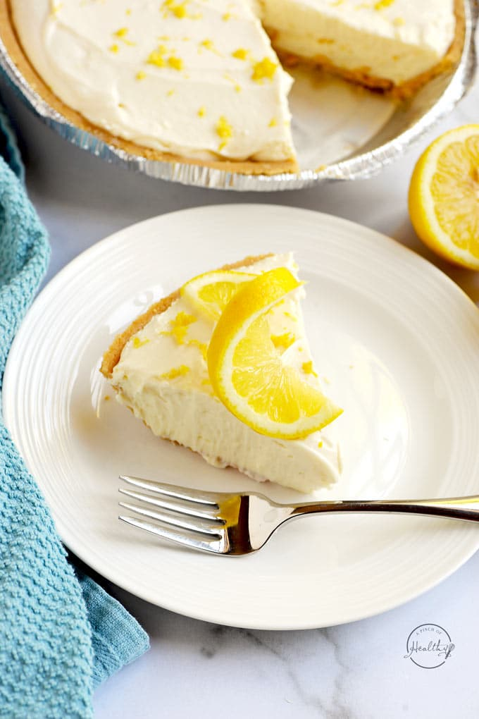 Slice of no bake lemon cheesecake on a white plate