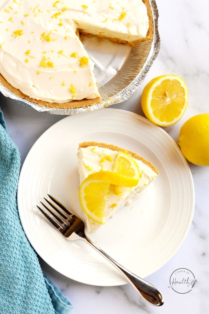 No bake lemon cheesecake with slice cut out from overhead