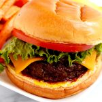 Air fryer burger with cheese, lettuce and tomato