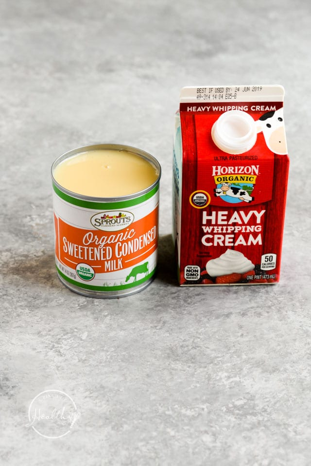 organic heavy cream and sweetened condensed milk on gray counter