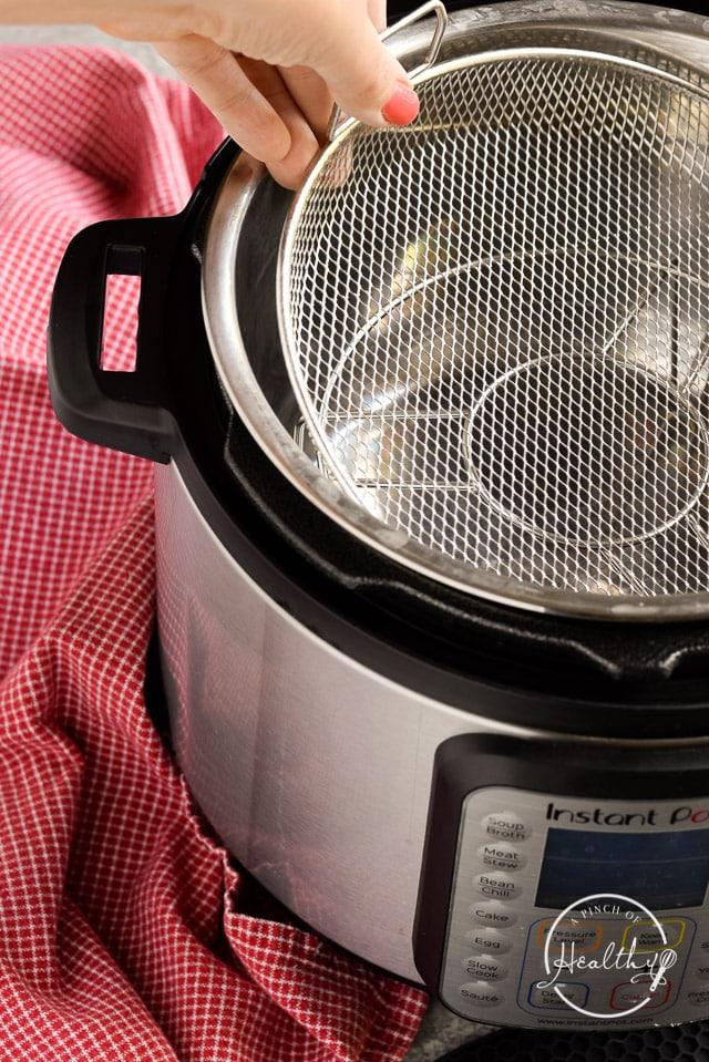 adding CrispLid air fryer basket to the Instant Pot