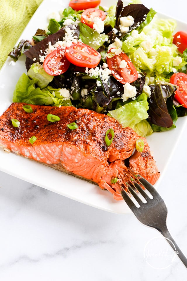 flaking air fryer salmon with a fork