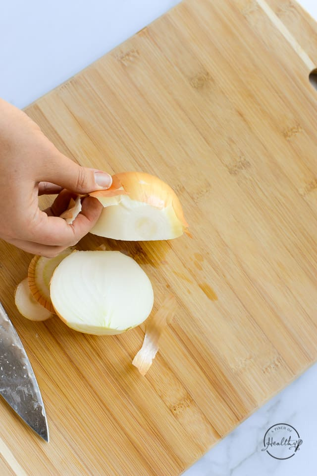 removing outer skins from onion