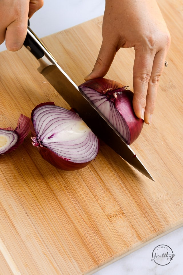 cutting a red onion in half