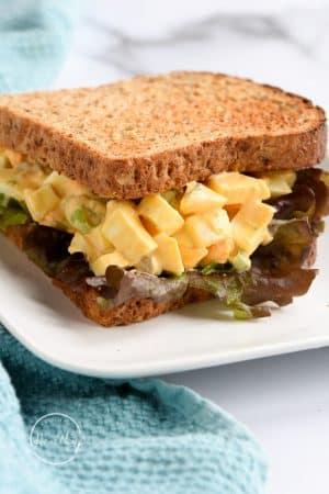 egg salad sandwich with lettuce on whole grain bread